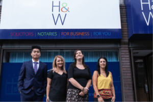 Hartley and Worstenholme solicitors in front of their offices